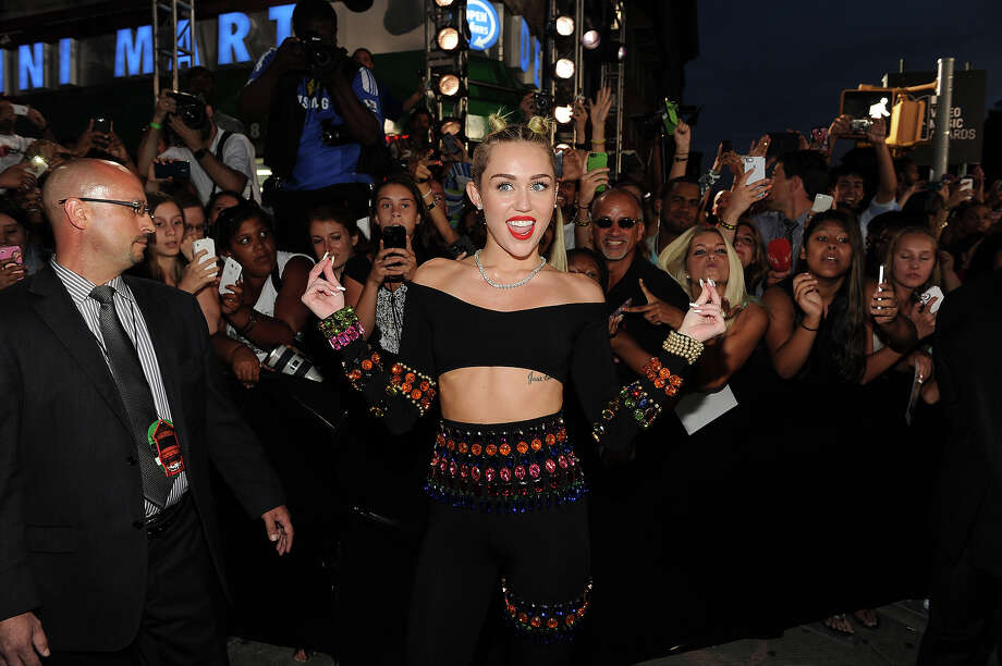 Miley Cyrus arrives on the red carpet at the 2013 MTV Video Music Awards at the Barclay Center on Sunday, Aug. 25, 2013 in New York. Photo: Frank Micelotta, Frank Micelotta/Invision/AP / Invision2013