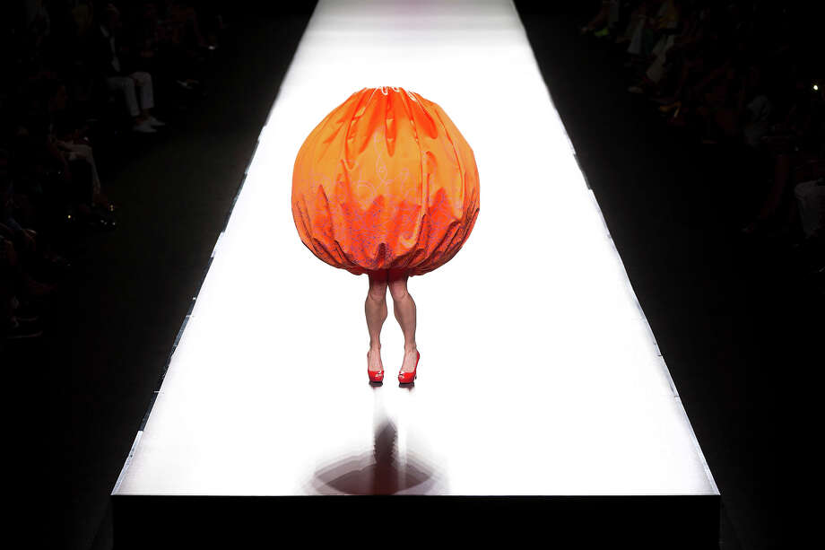 A model displays a Spring/Summer design by Agatha Ruiz de la Prada during Madrid's Fashion Week, in Madrid, Spain, Sunday, Sept. 15, 2013. Photo: Daniel Ochoa De Olza, AP / 2013 AP