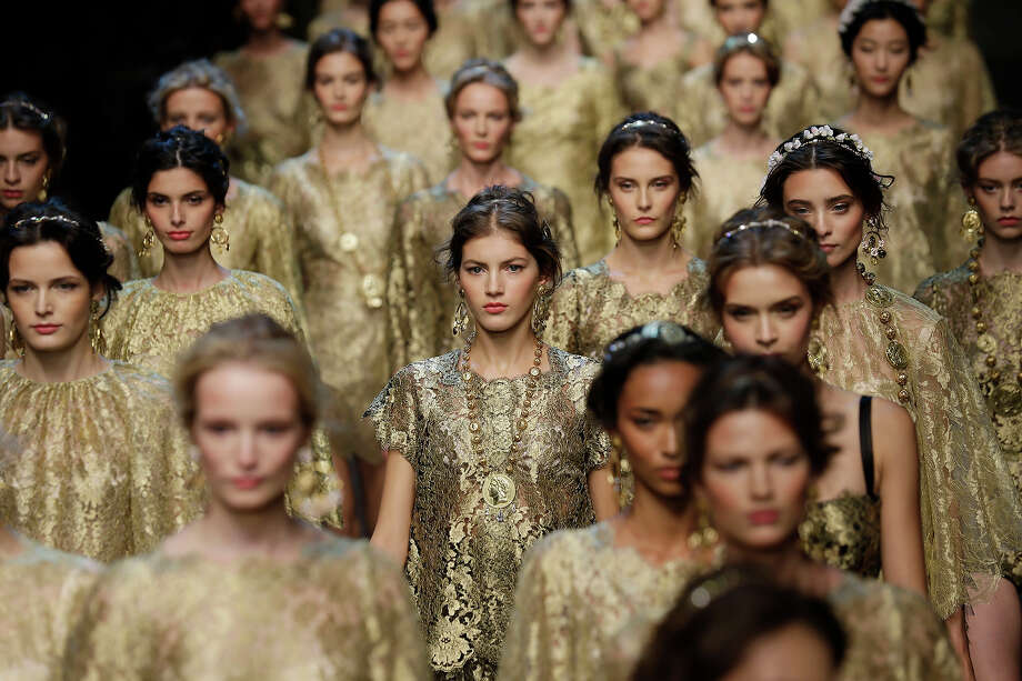 Models wear creations for Dolce & Gabbana women's Spring-Summer 2014 collection, part of the Milan Fashion Week, unveiled in Milan, Italy, Sunday, Sept. 22, 2013. Photo: Luca Bruno, AP / 2013 AP