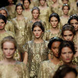 Models wear creations for Dolce & Gabbana women's Spring-Summer 2014 collection, part of the Milan Fashion Week, unveiled in Milan, Italy, Sunday, Sept. 22, 2013.