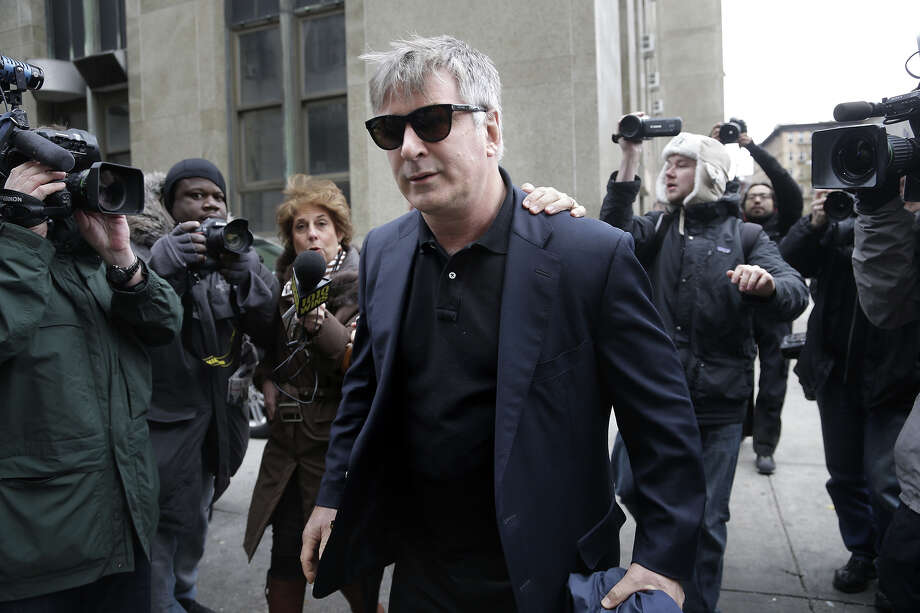 Actor Alec Baldwin leaves criminal court in New York, Tuesday, Nov. 12, 2013. Baldwin testified Tuesday that he never had a sexual or romantic relationship with Canadian actress Genevieve Sabourin, who accused of stalking him. He said that after they met she began leaving dozens of voice mails for him a night and eventually started threatening to show up at his homes. Photo: Seth Wenig, ASSOCIATED PRESS / AP2013