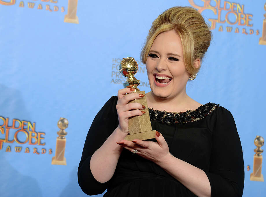 "Adele poses with the award for best original song in a motion picture for ""Skyfall"" backstage at the 70th Annual Golden Globe Awards at the Beverly Hilton Hotel on Sunday Jan. 13, 2013, in Beverly Hills, Calif. Photo: Jordan Strauss, Jordan Strauss/Invision/AP / AP2013"