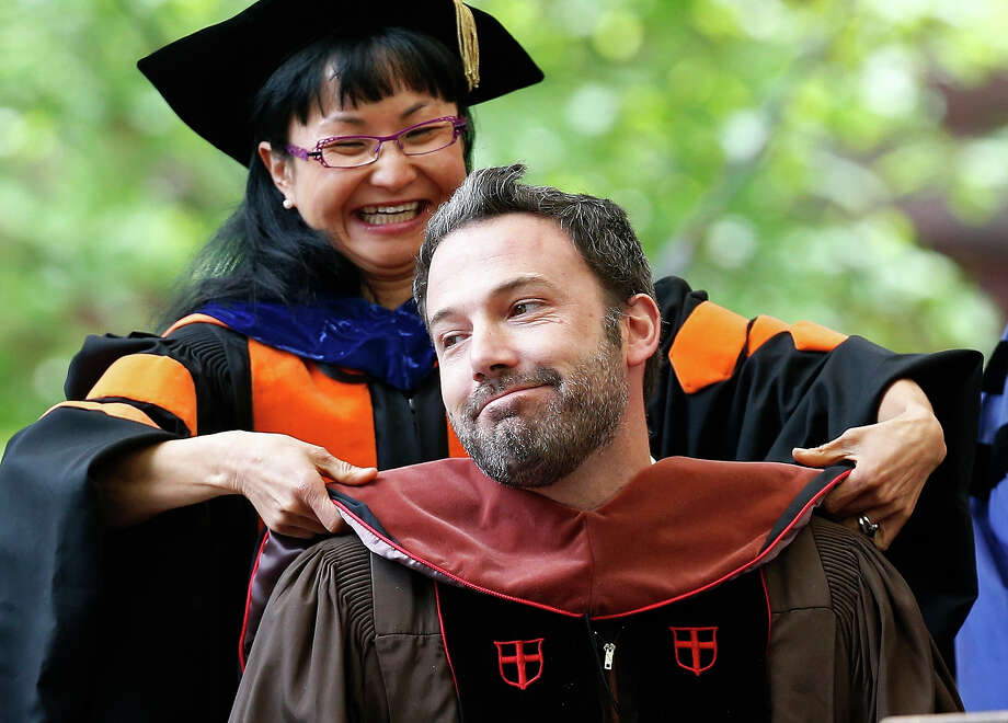 Ben Affleck reacts as he receives an honorary degree at Brown University's commencement in Providence, R.I., Sunday, May 26, 2013. Photo: Michael Dwyer, ASSOCIATED PRESS / AP2013