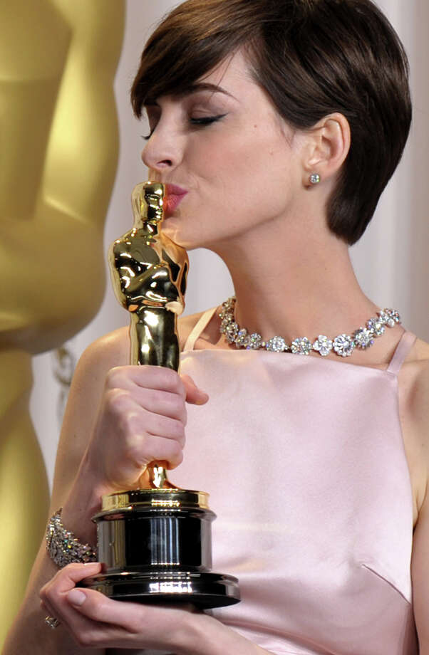 "Anne Hathaway poses with her award for best actress in a supporting role for ""Les Miserables"" during the Oscars at the Dolby Theatre on Sunday Feb. 24, 2013, in Los Angeles. Photo: John Shearer, John Shearer/Invision/AP / Invision2013"