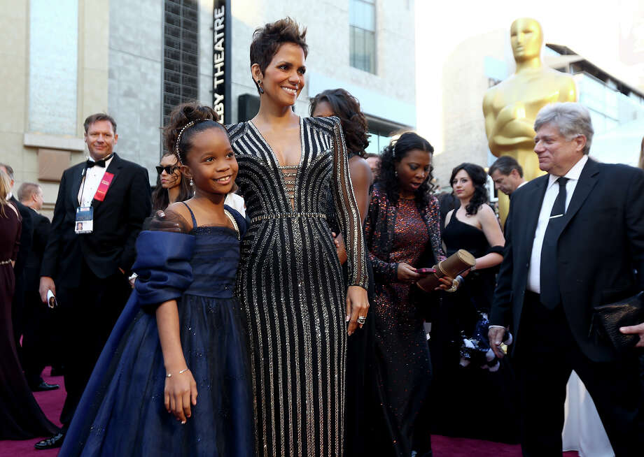 Actresses Quvenzhane Wallis, left, and Halle Berry arrive at the Oscars at the Dolby Theatre on Sunday Feb. 24, 2013, in Los Angeles. Photo: Matt Sayles, Matt Sayles/Invision/AP / Invision2013