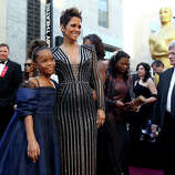 Actresses Quvenzhane Wallis, left, and Halle Berry arrive at the Oscars at the Dolby Theatre on Sunday Feb. 24, 2013, in Los Angeles.