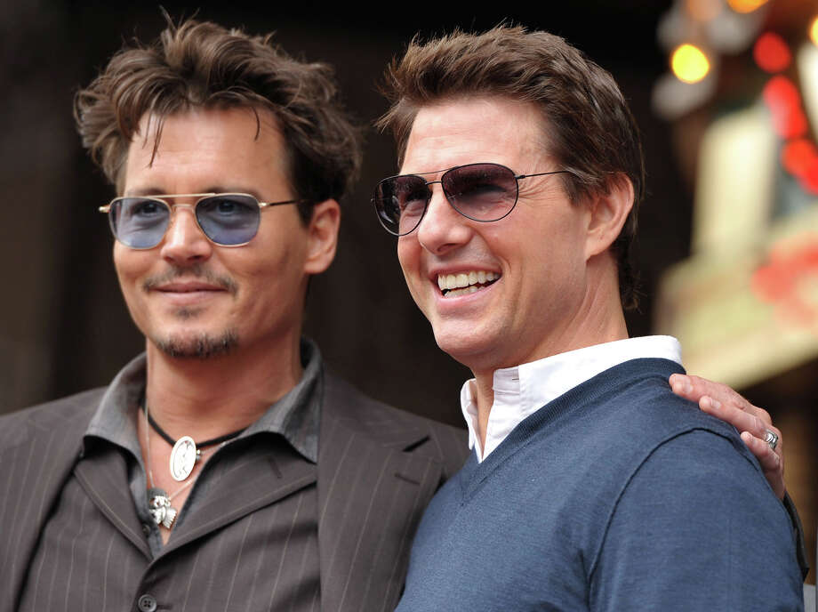 Actors Johnny Depp, left, and Tom Cruise appear at a ceremony honoring film producer Jerry Bruckheimer with a star on the Hollywood Walk of Fame on Monday, June 24, 2013 in Los Angeles. Photo: John Shearer, John Shearer/Invision/AP / AP2013