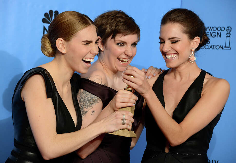 "Zosia Mamet, left, Lena Dunham, center, and Allison Williams pose with the award for best television series - comedy or musical for ""Girls"" backstage at the 70th Annual Golden Globe Awards at the Beverly Hilton Hotel on Sunday Jan. 13, 2013, in Beverly Hills, Calif. Photo: Jordan Strauss, Jordan Strauss/Invision/AP / AP2013"