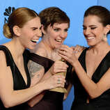 "Zosia Mamet, left, Lena Dunham, center, and Allison Williams pose with the award for best television series - comedy or musical for ""Girls"" backstage at the 70th Annual Golden Globe Awards at the Beverly Hilton Hotel on Sunday Jan. 13, 2013, in Beverly Hills, Calif."
