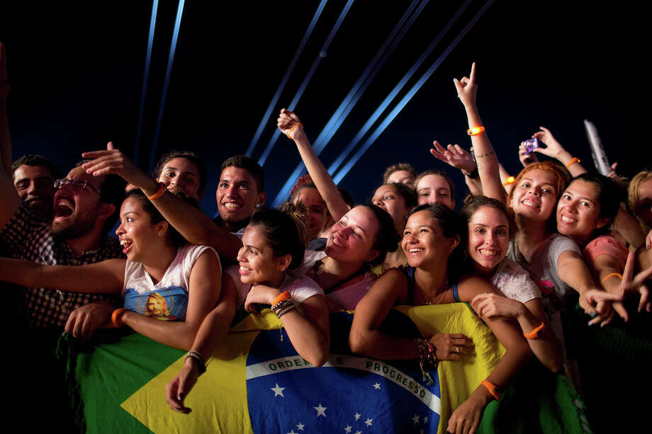 Fans watch the 'Tribute to Cazuza' show during the Rock in Rio music festival in Rio de Janeiro, Brazil, Friday, Sept. 13, 2013. Photo: Felipe Dana, AP / AP