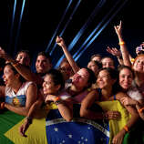 Fans watch the 'Tribute to Cazuza' show during the Rock in Rio music festival in Rio de Janeiro, Brazil, Friday, Sept. 13, 2013.