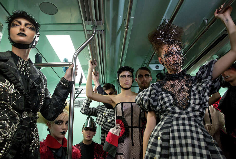 Models wearing collections of previous editions of the Sao Paulo Fashion Week, ride a subway train in Sao Paulo, Brazil, Sunday, Oct. 27, 2013. About 40 models participated in the event to promote the Sao Paulo Fashion Week, which runs from Oct. 28 until Nov. 1. Photo: Andre Penner, ASSOCIATED PRESS / AP2013