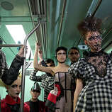 Models wearing collections of previous editions of the Sao Paulo Fashion Week, ride a subway train in Sao Paulo, Brazil, Sunday, Oct. 27, 2013. About 40 models participated in the event to promote the Sao Paulo Fashion Week, which runs from Oct. 28 until Nov. 1.