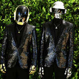 Thomas Bangalter, right, and Guy-Manuel de Homem-Christo, from the group Daft Punk pose for a portrait on Wednesday, April 17, 2013 in Los Angeles.