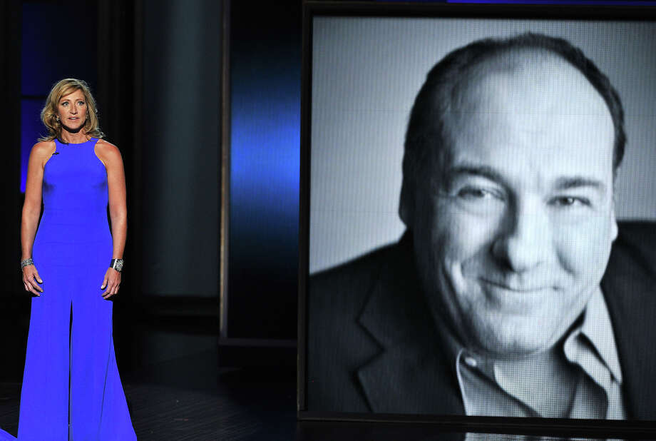 Edie Falco presents a tribute to James Gandolfini, who is featured on screen at right, at the 65th Primetime Emmy Awards at Nokia Theatre on Sunday Sept. 22, 2013, in Los Angeles. Photo: Vince Bucci, Vince Bucci/Invision/AP / Invision2013