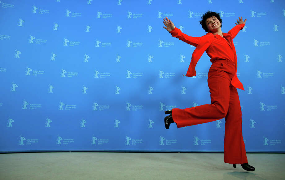 Actress Juliette Binoche jumps during the photo call for the film Camille Claudel 1915 at the 63rd edition of the Berlinale, International Film Festival in Berlin, Tuesday, Feb. 12, 2013. Photo: Gero Breloer, ASSOCIATED PRESS / AP2013