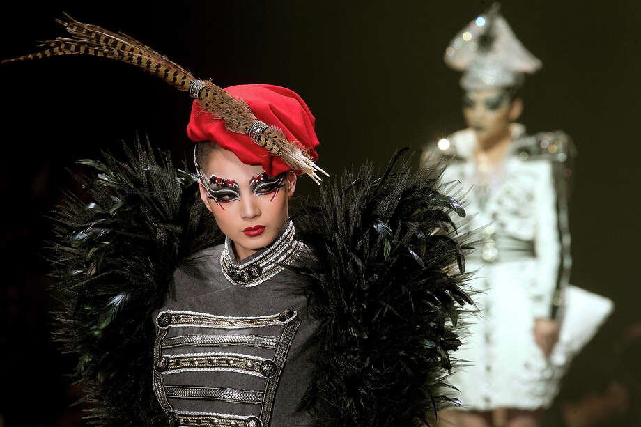 A model shows off the latest creations from the Mao Geping stylist collection during a show for fashion week in Beijing, China, Wednesday, March 27, 2013. Photo: Ng Han Guan, AP / 2013 AP