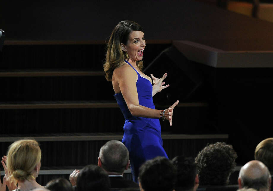 Tina Fey walks to the stage to accept the award for outstanding writing for a comedy series for ì30 Rockî at the 65th Primetime Emmy Awards at Nokia Theatre on Sunday Sept. 22, 2013, in Los Angeles. Photo: Chris Pizzello, Chris Pizzello/Invision/AP / AP2013