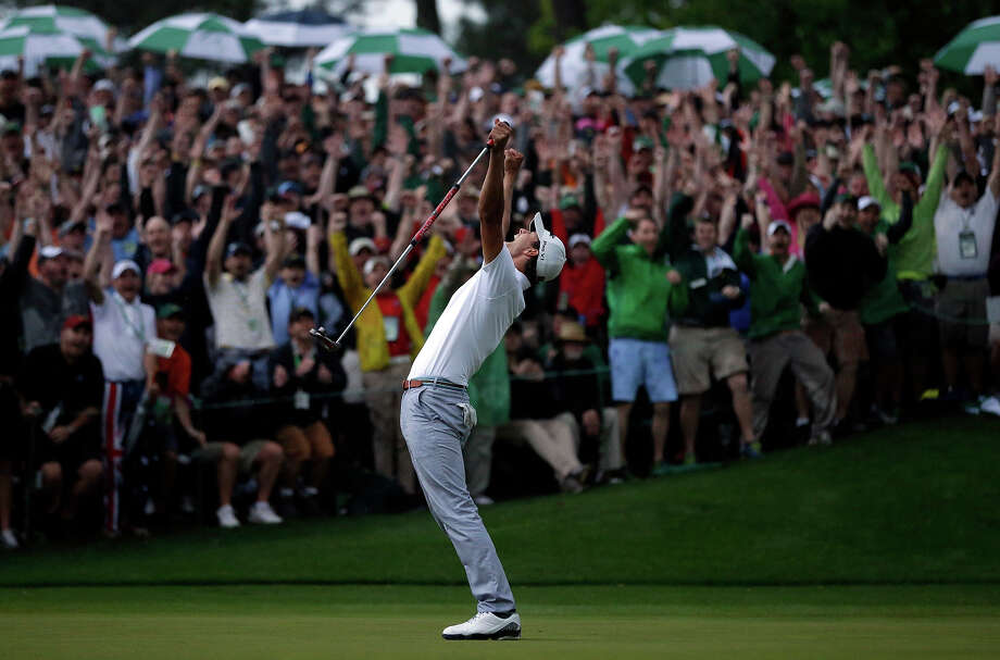 Adam Scott, of Australia, celebrates after making a birdie putt on the second playoff hole to win the Masters golf tournament Sunday, April 14, 2013, in Augusta, Ga. Photo: David J. Phillip, ASSOCIATED PRESS / AP2013
