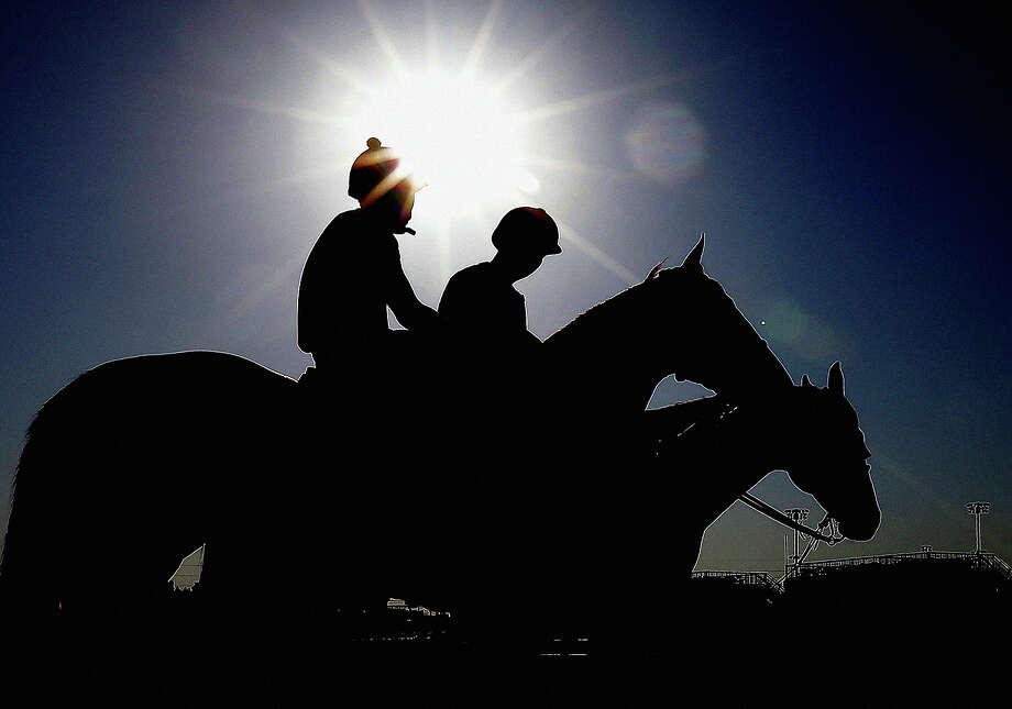 Exercise rider Emerson Chavez waits to take Kentucky Derby hopeful Golden Soul for a workout at Churchill Downs Wednesday, May 1, 2013, in Louisville, Ky. Photo: Morry Gash, ASSOCIATED PRESS / AP2013