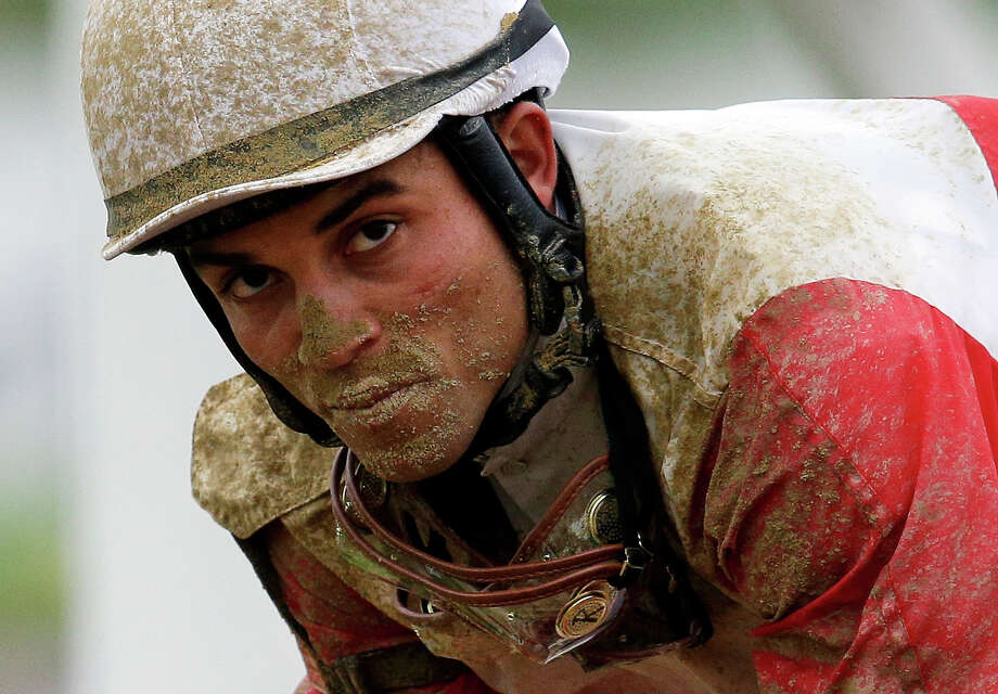 Jockey Joel Rosario gallops orb back to the paddock after the 138th Preakness Stakes horse race at Pimlico Race Course, Saturday, May 18, 2013, in Baltimore. Oxbow won the race. Orb, the Kentucky Derby winner, finished fourth. Photo: Patrick Semansky, ASSOCIATED PRESS / AP2013