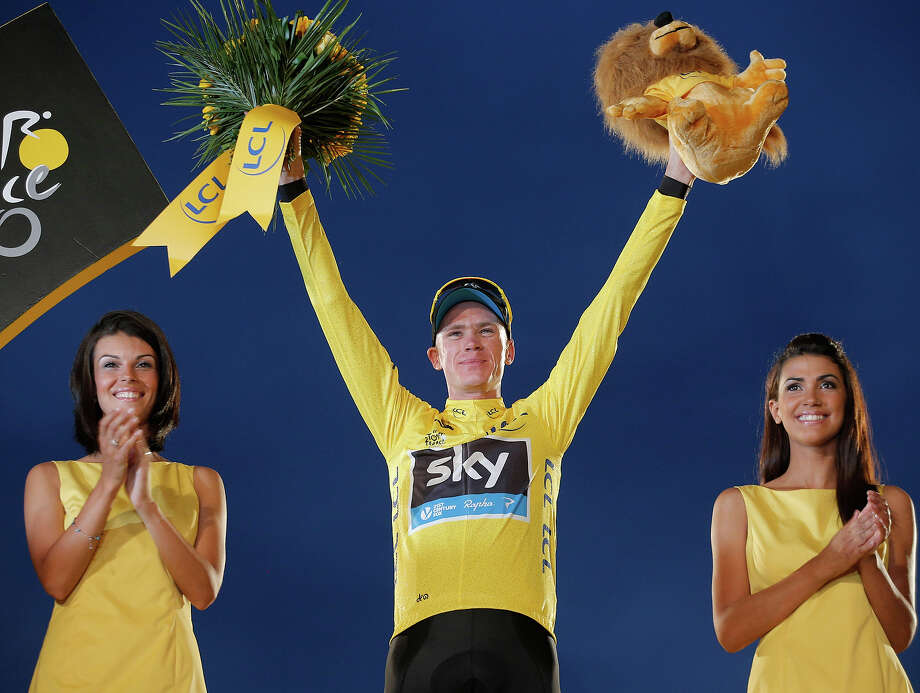 2013 Tour de France cycling race winner Christopher Froome of Britain, wearing the overall leader's yellow jersey, celebrates on the podium of the 100th edition of the Tour de France cycling in Paris, France, Sunday July 21 2013. Photo: Christophe Ena, ASSOCIATED PRESS / AP2013