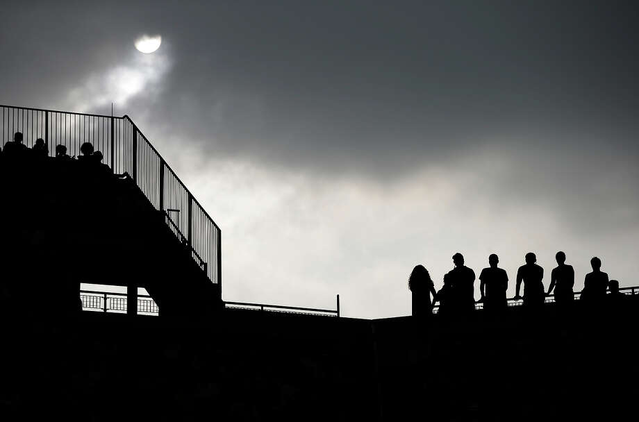 Tennis fans watch play under darkening skies during the fourth round of the 2013 U.S. Open tennis tournament, Monday, Sept. 2, 2013, in New York. Photo: Darron Cummings, ASSOCIATED PRESS / AP2013