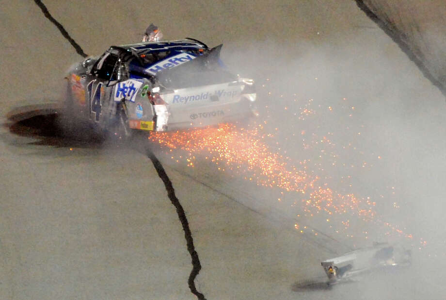 Driver Jeff Green (14) blows an engine and loses a bumper late in the Nationwide Series auto race at Atlanta Motor Speedway, Saturday, Aug. 31, 2013, in Hampton, Ga. Photo: Joe Sebo, ASSOCIATED PRESS / AP2013