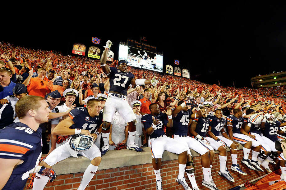 Auburn players celebrate their 30-22 win against Mississippi during an NCAA college football game on Saturday, Oct. 5, 2013, in Auburn, Ala. Photo: Todd J. Van Emst, AP / AP 8775