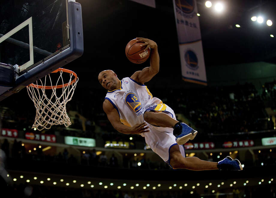 A member of the Flying Dubs, an acrobatic dunk team of the Golden State, Warriors performs during the NBA Global Games match between Golden State Warriors and LA Lakers at the Wukesong Stadium in Beijing, Tuesday, Oct. 15, 2013. Photo: Andy Wong, ASSOCIATED PRESS / AP2013