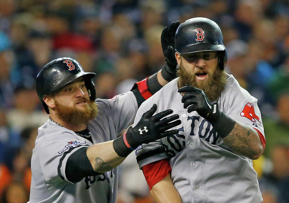Boston Red Sox's Mike Napoli, right, is greeted by Jonny Gomes following a home run by Napoli in the second inning during Game 5 of the American League baseball championship series against the Detroit Tigers, Thursday, Oct. 17, 2013, in Detroit. Photo: Paul Sancya, ASSOCIATED PRESS / AP2013