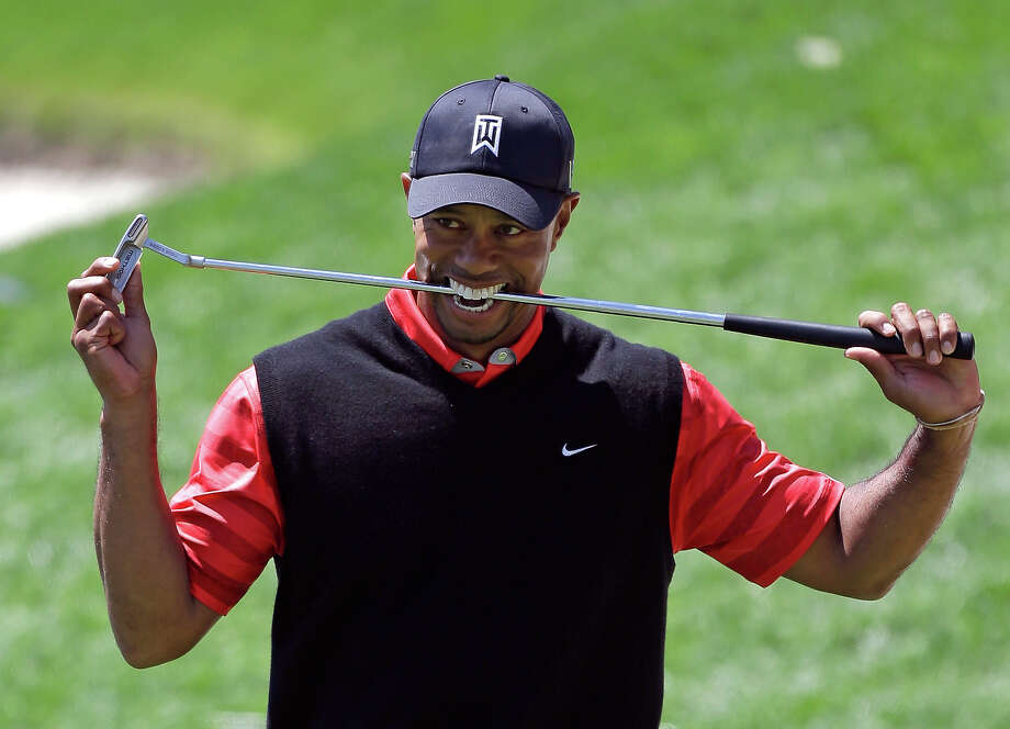 Tiger Woods bites down on his club after missing a putt for par on the 18th green during the final round of the Arnold Palmer Invitational golf tournament, Monday, March 25, 2013, in Orlando, Fla. Woods won the tournament with a 13-under-par total. Photo: John Raoux, ASSOCIATED PRESS / AP2013