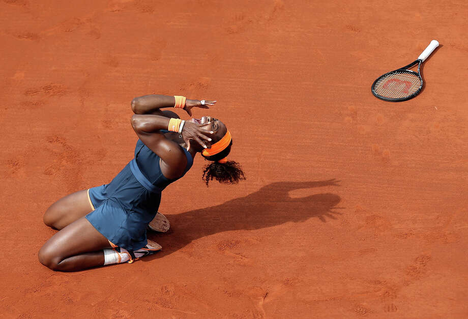 Serena Williams, of the U.S, celebrates as she defeats Russia's Maria Sharapova during the Women's final match of the French Open tennis tournament at the Roland Garros stadium Saturday, June 8, 2013 in Paris. Williams won 6-4, 6-4. Photo: David Vincent, ASSOCIATED PRESS / AP2013