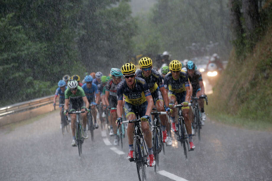 The pack with Michael Rogers of Australia, front, Roman Kreuziger of the Czech Republic, in second position, Spain's Alberto Contador in third position, and Bauke Mollema of The Netherlands, left in green, climbs la Croix Fry pass in a downpour during the nineteenth stage of the Tour de France cycling race over 204.5 kilometers (127.8 miles) with start in in Bourg-d'Oisans and finish in Le Grand-Bornand, France, Friday July 19 2013. Photo: Christophe Ena, ASSOCIATED PRESS / AP2013