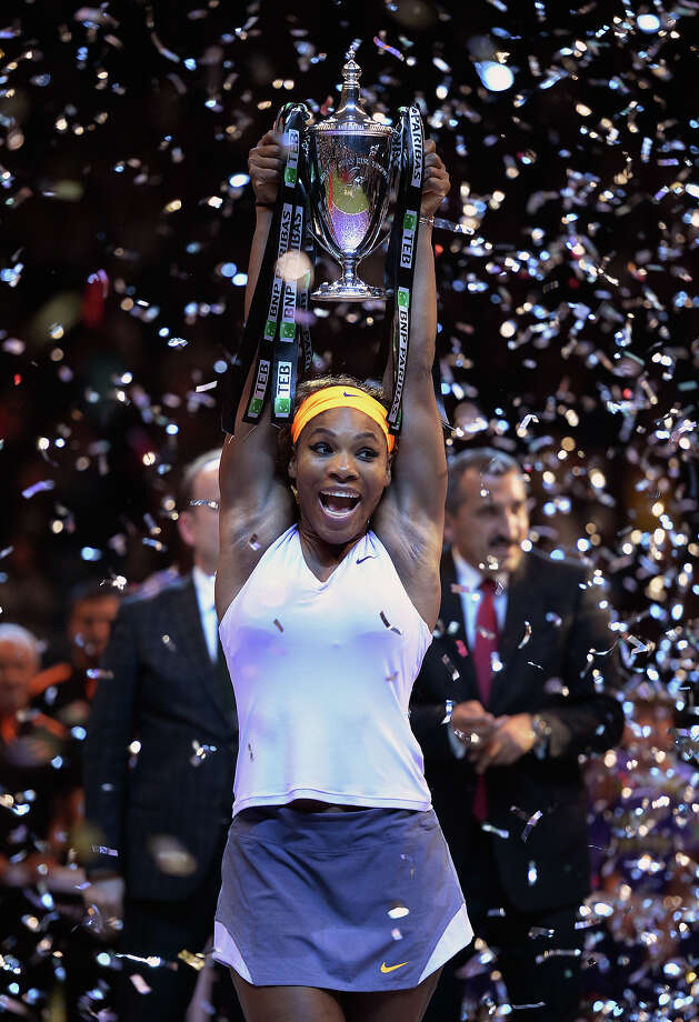 Serena Williams of the U.S shouts as she holds up the trophy after her victory over Li Na of China in the final of the WTA Championship in Istanbul, Turkey, Sunday, Oct. 27, 2013. The world's top female tennis players compete in the championships which runs from Oct. 22 until Oct. 27. Photo: Uncredited, ASSOCIATED PRESS / AP2013