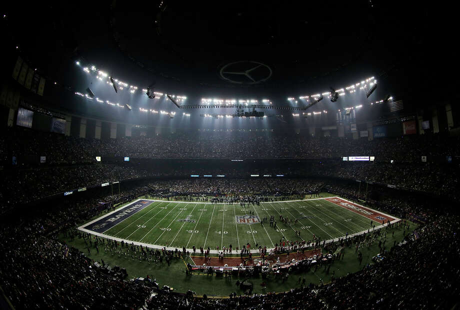 Fans and members of the Baltimore Ravens and San Francisco 49ers wait for power to return in the Superdome during an outage in the second half of the NFL Super Bowl XLVII football game, Sunday, Feb. 3, 2013, in New Orleans. Photo: Charlie Riedel, ASSOCIATED PRESS / AP2013