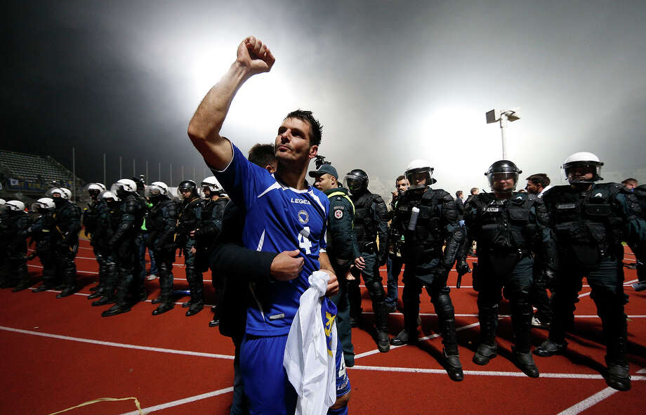 Bosnia's  Emir Spahic celebrates victory during the World Cup group G qualifying soccer match between  Lithuania and Bosnia in Kaunas, Lithuania, Tuesday, Oct. 15, 2013. Photo: Mindaugas Kulbis, ASSOCIATED PRESS / AP2013