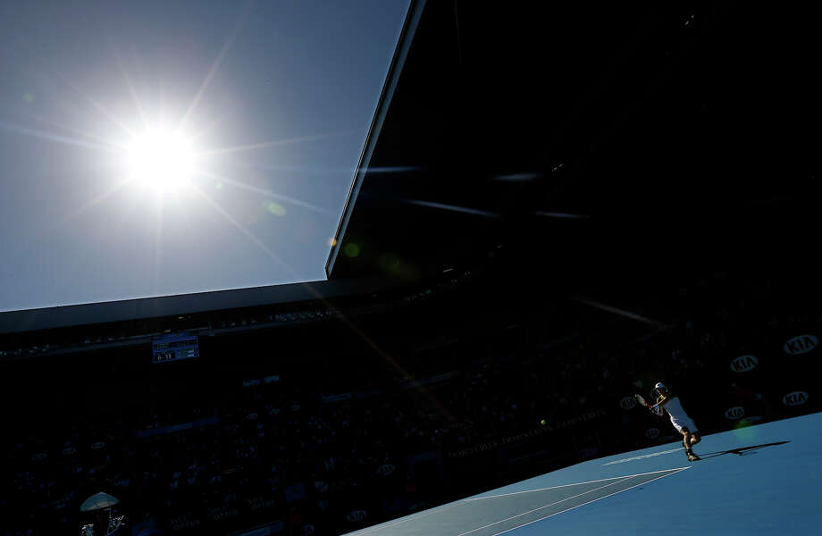 Britain's Andy Murray makes a backhand return to Lithuania's Ricardas Berankis during their third round match at the Australian Open tennis championship in Melbourne, Australia, Saturday, Jan. 19, 2013. Photo: Andy Wong, ASSOCIATED PRESS / AP2013