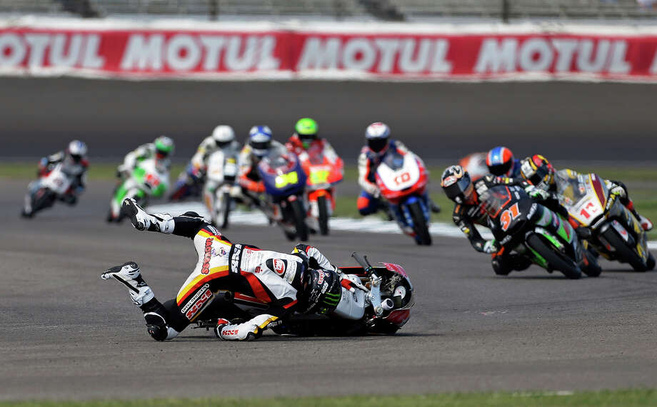 Australian Jack Miller wrecks during the Indianapolis Grand Prix Moto3 motorcycle race at the Indianapolis Motor Speedway Sunday, Aug. 18, 2013, in Indianapolis. Photo: Darron Cummings, ASSOCIATED PRESS / AP2013