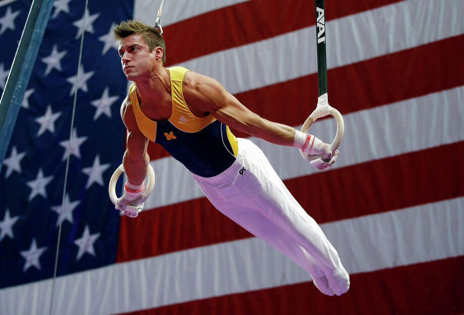 Sam Mikulak competes on the rings during the U.S. men's national gymnastics championships in Hartford, Conn., Sunday, Aug. 18, 2013. Photo: Elise Amendola, ASSOCIATED PRESS / AP2013