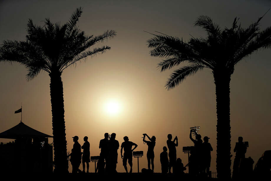 Spectators watch the second free practice at the Yas Marina racetrack in Abu Dhabi, United Arab Emirates, Friday, Nov. 1, 2013. The Emirates Formula One Grand Prix will take place on Sunday. Photo: Hassan Ammar, ASSOCIATED PRESS / AP2013