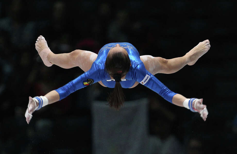 Larisa Andreea Iordache from Romania performs on the uneven bars, during the qualification round at the artistic gymnastics World Championships in Antwerp, Belgium, Wednesday, Oct. 2, 2013. The event takes place until Sunday, Oct. 6. Photo: Yves Logghe, ASSOCIATED PRESS / AP2013