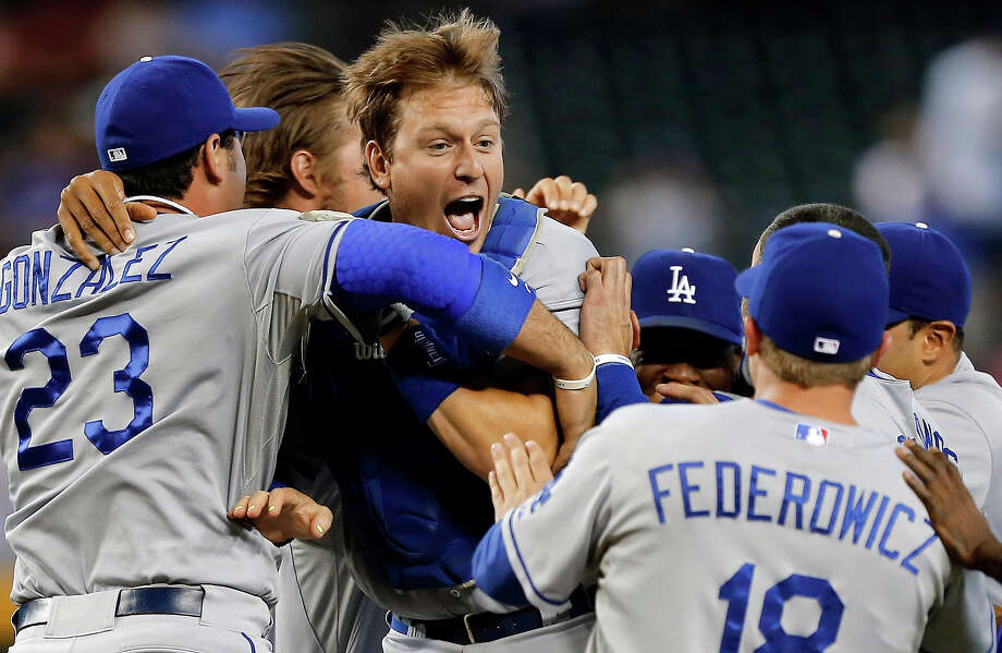 The Los Angeles Dodgers celebrate a 7-6 win over the Arizona Diamondbacks in a baseball game on Thursday, Sept. 19, 2013, in Phoenix. The Dodgers clinched the National League West title. Photo: Matt York, ASSOCIATED PRESS / AP2013