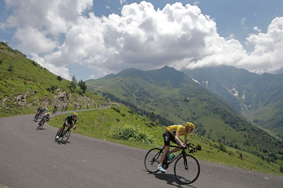 Christopher Froome of Britain, wearing the overall leader's yellow jersey, and Nairo Alexander Quintana of Colombia, wearing the best young rider's white jersey, in third position, speed down Val Louron-Azet pass during the ninth stage of the Tour de France cycling race over 168.5 kilometers (105.3 miles) with start in Saint-Girons and finish in Bagneres-de-Bigorre, Pyrenees region, France, Sunday July 7, 2013. Photo: Laurent Cipriani, ASSOCIATED PRESS / AP2013