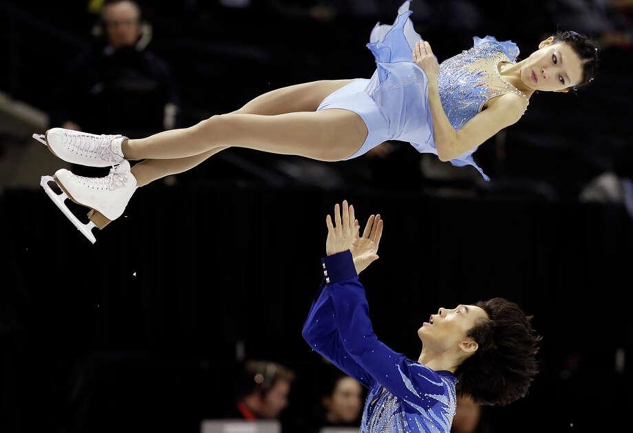 Pang Qing and Tong Jian, of China, perform during the pairs free program at the World Figure Skating Championships Friday, March 15, 2013, in London, Ontario. Photo: Darron Cummings, ASSOCIATED PRESS / AP2013