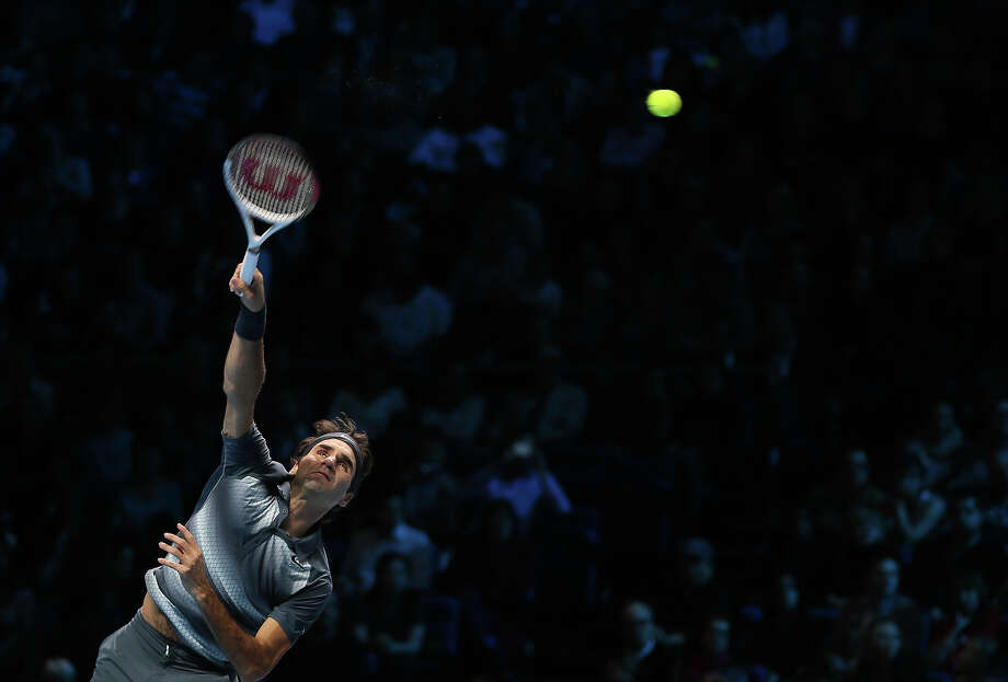 Roger Federer of Switzerland serves to Rafael Nadal of Spain during their ATP world Tour Finals tennis semifinal match at the O2 Arena on London, Sunday, Nov. 10, 2013. Photo: Alastair Grant, ASSOCIATED PRESS / AP2013