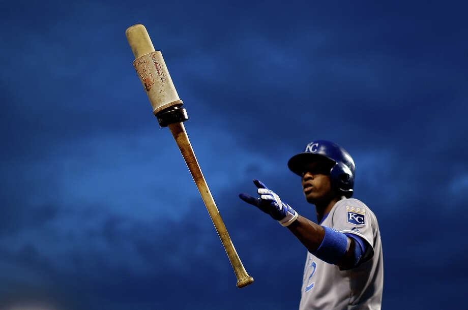 Kansas City Royals' Alcides Escobar flips his bat in the air as he prepares for an at-bat in the second inning of a baseball game against the Baltimore Orioles in Baltimore, Thursday, May 9, 2013. Photo: Patrick Semansky, ASSOCIATED PRESS / AP2013