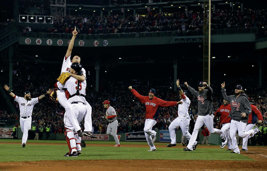 Boston Red Sox relief pitcher Koji Uehara and catcher David Ross celebrate after getting St. Louis Cardinals' Matt Carpenter to strike out and end Game 6 of baseball's World Series Wednesday, Oct. 30, 2013, in Boston. The Red Sox won 6-1 to win the series. Photo: Matt Slocum, ASSOCIATED PRESS / AP2013