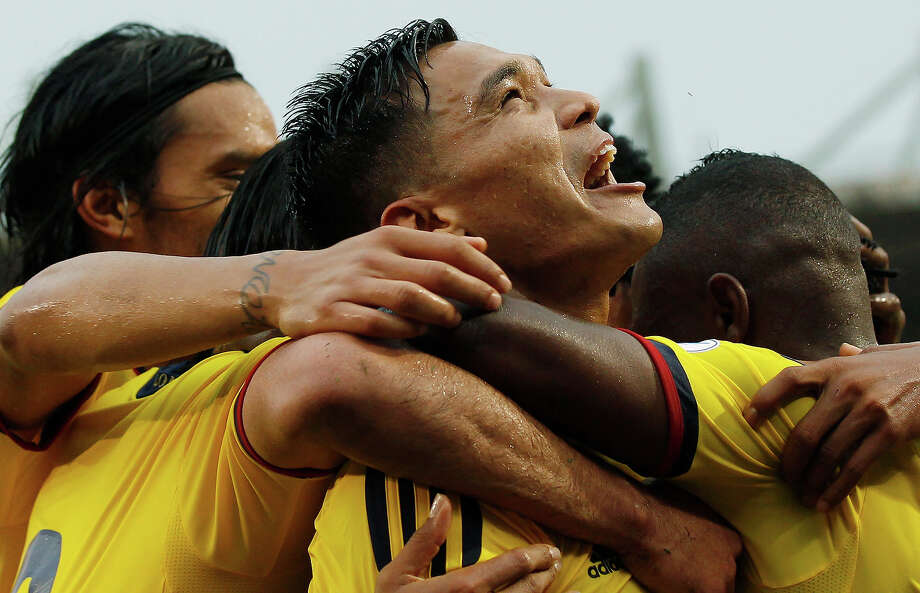 Colombia's Teofilo Gutierrez, center, celebrates with teammates after scoring against Peru during a 2014 World Cup qualifying soccer match in Barranquilla, Colombia, Tuesday, June 11, 2013. Photo: Fernando Vergara, AP / AP