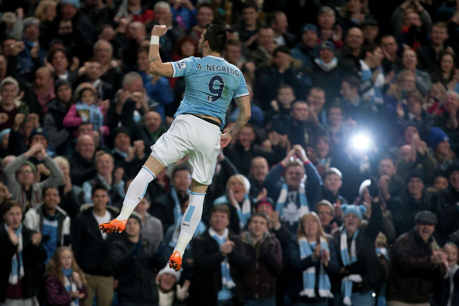 Manchester City's Alvaro Negredo celebrates after scoring against Swansea City during their English Premier League soccer match at the Etihad Stadium, Manchester, England, Sunday Dec. 1, 2013. Photo: Jon Super, ASSOCIATED PRESS / AP2013